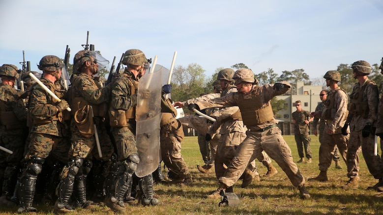 A riot control squad, comprised of Marines with Combat Logistics Battalion 2, confronts a notional opposing force during the unit's non-lethal weapons training final exercise at Marine Corps Base Camp Lejeune, North Carolina, March 25, 2016. The battalion had to qualify through the Expeditionary Operations Training Group in preparation for their upcoming deployment with Special Purpose Marine Air-Ground Task Force-Crisis Response-Africa.