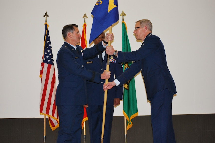 Western Air Defense Sector, Vice Commander, Col. Ronald D. Harmon, receives the 225th Air Defense Group guidon from Brig. Gen. John S. Tuohy, Washington state assistant adjutant general - Air, during the activation and assumption of command ceremony, Joint Base Lewis-McChord, May 2, 2015. WADS is responsible for air sovereignty and counter-air operations over the western United States and directs a variety of assets to defend 2.2 million square miles of land and sea. (U.S. Air National Guard photo by 1st Lt. Colette D. Muller/Released)