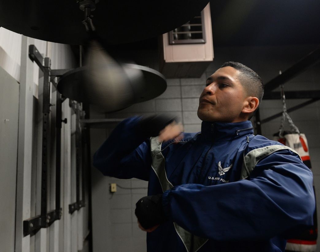 First Lt. Christian Torres, 81st Comptroller Squadron deputy project officer, hits a speed bag at the Triangle Gym, March 3, 2016, Keesler Air Force Base, Miss. Torres boxed recreationally and had the opportunity to become a professional boxer, however, due to family needs he chose his current path in the U.S. Air Force. (U.S. Air Force Photo by Airman 1st Class Travis Beihl)