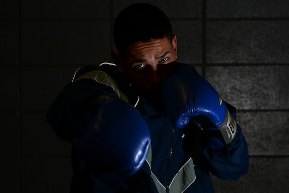 First Lt. Christian Torres, 81st Comptroller Squadron deputy project officer, throws a right hook at the Triangle Gym, March 3, 2016, Keesler Air Force Base, Miss. Torres boxed recreationally and had the opportunity to become a professional boxer, however, due to family needs he chose his current path in the U.S. Air Force. (U.S. Air Force Photo by Airman 1st Class Travis Beihl)
