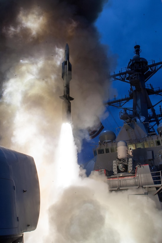 The guided missile destroyer USS John Paul Jones launches a Standard Missile-6 during a live-fire test of the ship's aegis weapons system, June 19, 2014. Over the course of three days, the crew of John Paul Jones successfully engaged six targets, firing a total of five missiles that included four SM-6 models and one SM-2 model. Navy photo