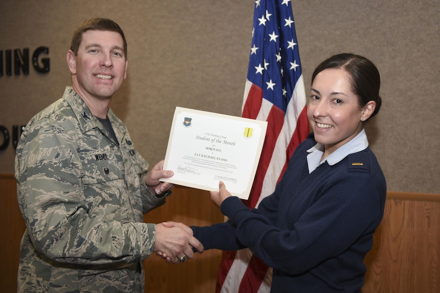 U.S. Air Force Col. Kurt A. Wendt, 17th Training Group Deputy Commander, presents the 315th Training Squadron Officer Student of the Month award for March 2016 to U.S. Air Force 2nd Lt. Rachael Evans at the Brandenburg Hall on Goodfellow Air Force Base, Texas, April 1, 2016. (U.S. Air Force photo by Airman Chase Sousa/Released)
