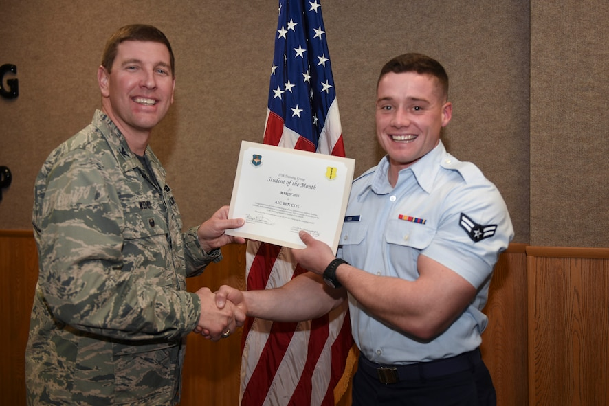 U.S. Air Force Col. Kurt A. Wendt, 17th Training Group Deputy Commander, presents the 312th Training Squadron Enlisted Student of the Month award for March 2016 to Airman 1st Class Ben Cox at the Brandenburg Hall on Goodfellow Air Force Base, Texas, April 1, 2016. (U.S. Air Force photo by Airman Chase Sousa/Released)