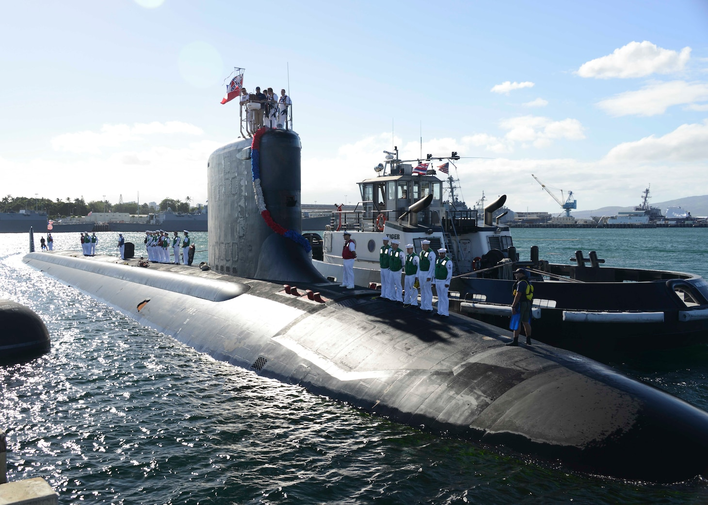 PEARL HARBOR (Nov. 25, 2014) The Virginia-class attack submarine USS Mississippi (SSN 782) arrives at Joint Base Pearl Harbor-Hickam for a change of homeport from Commander, Submarine Squadron (SUBRON) 4 in Groton, Conn., to SUBRON-1. Mississippi is the 4th Virginia-class submarine to be home ported in Pearl Harbor, and one of 18 attack submarines permanently homeported at the historic base. (U.S. Navy photo by Mass Communication Specialist 1st Class Steven Khor/Released)