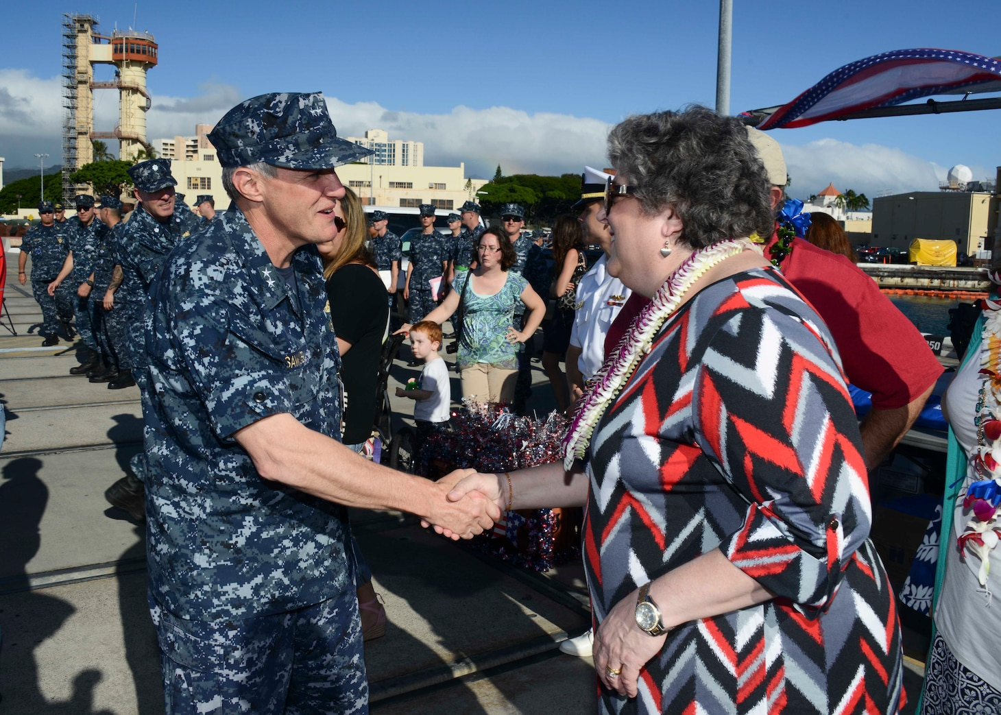 PEARL HARBOR (Nov. 25, 2014) Rear Adm. Phil Sawyer, commander of Submarine Force, U.S. Pacific Fleet, greets Allison Stiller, deputy assistant secretary of the Navy for ship programs and ship sponsor of the Virginia-class attack submarine USS Mississippi (SSN 782), during an arrival ceremony as Mississippi is welcomed to its new homeport at Joint Base Pearl Harbor-Hickam. Mississippi is the 4th Virginia-class submarine to be home ported in Pearl Harbor, and one of 18 attack submarines permanently homeported at the historic base. (U.S. Navy photo by Mass Communication Specialist 1st Class Steven Khor/Released)