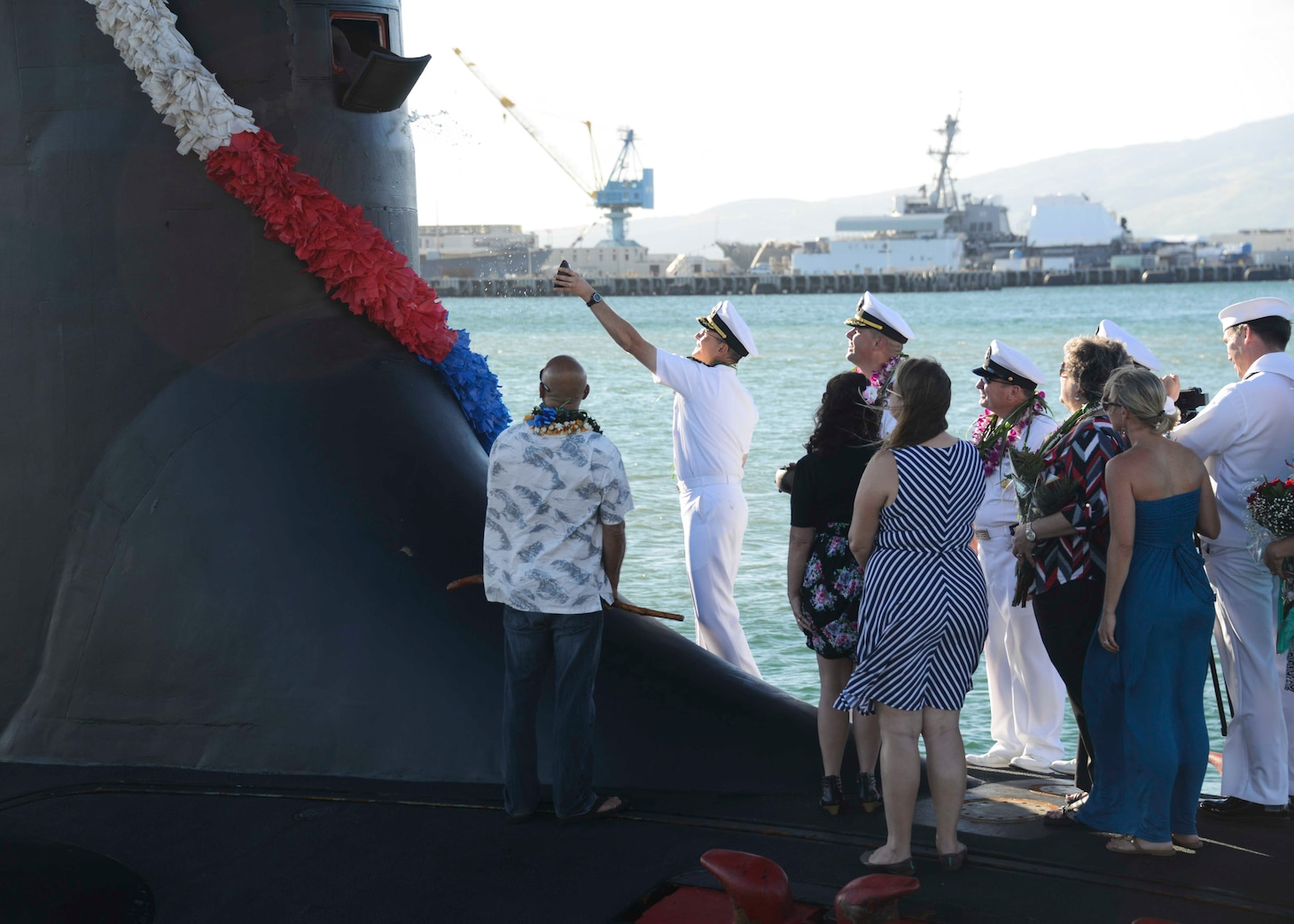 141125-N-DB801-373 PEARL HARBOR, Hawaii (Nov. 25, 2014) Capt. Harry Ganteaume, commodore of Submarine Squadron (SUBRON) 1, participates in a traditional Hawaiian blessing ceremony of the Virginia-class attack submarine USS Mississippi (SSN 782) upon the ship's arrival at Joint Base Pearl Harbor-Hickam. Mississippi is changing homeport from Commander, Submarine Squadron 4 in Groton, Conn. to Commander, Submarine Squadron 1. Mississippi makes is the 4th Virginia-class submarine to be home ported in Pearl Harbor, and one of 18 attack submarines permanently homeported at the historic base. (U.S. Navy photo by Mass Communication Specialist 1st Class Steven Khor/Released)