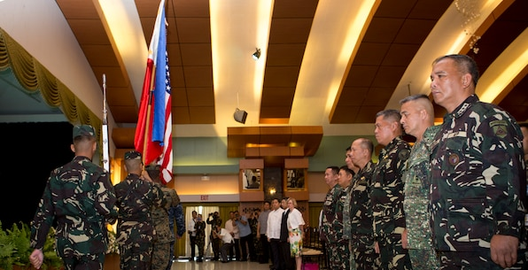 """Flags from both nations are retired, during the opening ceremony of Balikatan 2016, aboard Camp Aguinaldo, April 4, 2016. Balikatan, which means """"shoulder to shoulder"""" in Filipino, is an annual bilateral training exercise focused on improving the ability of Philippine and U.S. military forces to work together during planning, contingency and humanitarian assistance and disaster relief operations. This year marks the 32nd iteration of the exercise. (U.S. Marine Corps photo by Sgt. Erik Estrada)"""