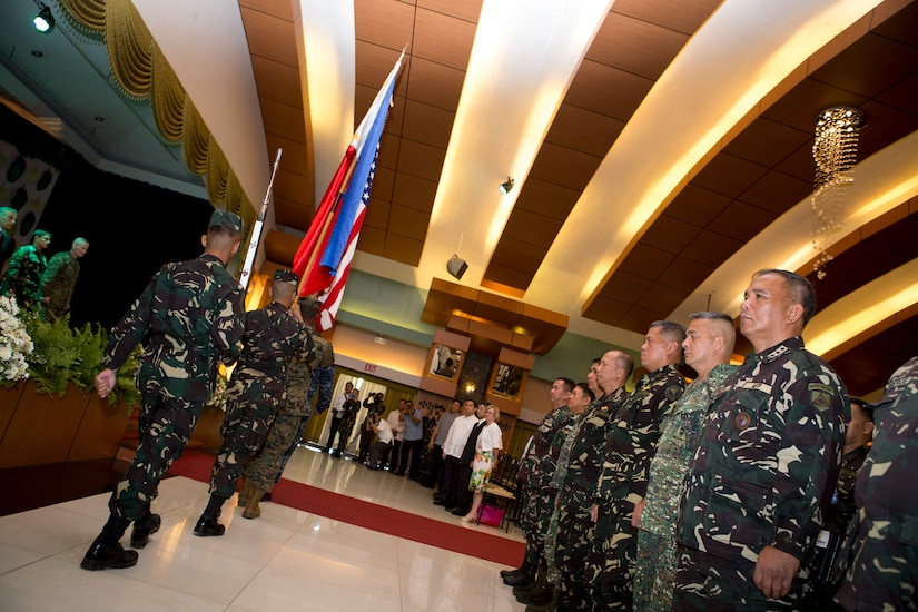 """Flags from both nations are retired, during the opening ceremony of Balikatan 2016, aboard Camp Aguinaldo, April 4, 2016. Balikatan, which means """"shoulder to shoulder"""" in Filipino, is an annual bilateral training exercise focused on improving the ability of Philippine and U.S. military forces to work together during planning, contingency and humanitarian assistance and disaster relief operations. This year marks the 32nd iteration of the exercise."""
