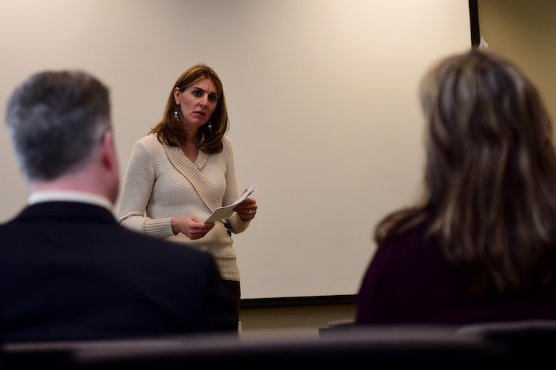 Christina Grooms, 460th Space Wing community support coordinator, listens to Team Buckley members March 28, 2016, during a Caring for People forum at Chapel on Buckley Air Force Base, Colo. The forum provided Team Buckley with an opportunity to discuss topics of concern and share opinions about the local community. (U.S. Air Force photo by Airman 1st Class Gabrielle Spradling/Released)