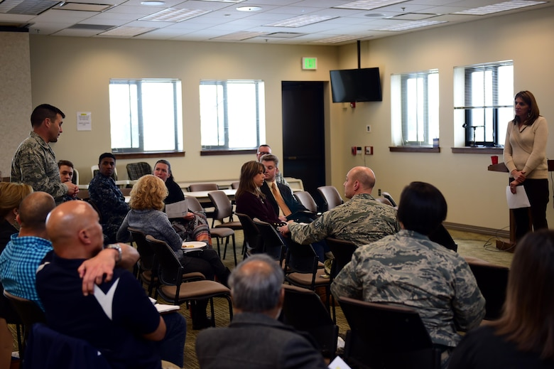 Col. John Wagner, 460th Space Wing commander, and Christina Grooms, 460th Space Wing community support coordinator, discuss various based topics March 28, 2016, during a Caring for People forum at the Chapel on Buckley Air Force Base, Colo. The forum gave Team Buckley members a chance to express concerns affecting the military and civilian communities. (U.S. Air Force photo by Airman 1st Class Gabrielle Spradling/Released)