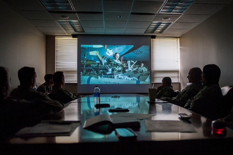 Members of the 314th Aircraft Maintenance Squadron watch the Profession of Arms Center of Excellence video March 23, 2016, on Little Rock Air Force Base, Ark. The PACE program is an option for U.S. Air Force members to become the best possible leaders. (U.S. Air Force photo by Senior Airman Stephanie Serrano)