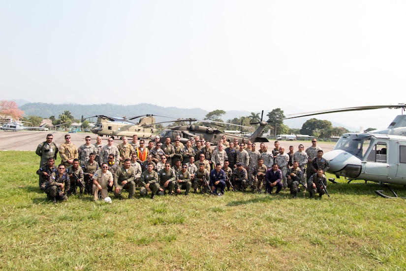 Representatives from the Honduran Fire Department, Air Force and Army pose for a group photo with U.S. Servicemembers from Joint Task Force-Bravo, 1-228th Aviation Regiment after working together in firefighting mission near Tela, Honduras, April 02, 2016. The U.S. responded to the request of Honduran President Juan Orlando Hernandez to assist the Honduran forces with air capabilities to extinguish the forest fire in Jeanette Kawas National Park. (Courtesy photo by Chief Warrant Officer Kyle Johnson)