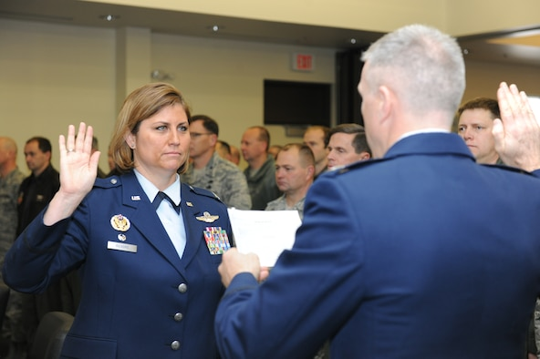 Col. Michele Kilgore, 174th Operations Group commander, takes the oath of office from her husband, Col. Robert Kilgore, 107th Attack Wing commander, during her promotion ceremony at Hancock Field Air National Guard Base, April 3. (U.S. Air National Guard photo by Tech. Sgt. Justin A. Huett/Released)