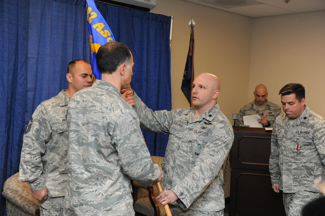 Lt. Col. Anthony Pasquale (right) receives the 274th Air Support Operations Squadron's guidon from Col. Michael Comella, the 152nd Air Operations Group commander, during a change of command ceremony held at Hancock Field Air National Guard Base, April 3. (U.S. Air National Guard photo by Tech. Sgt. Justin A. Huett/Released)