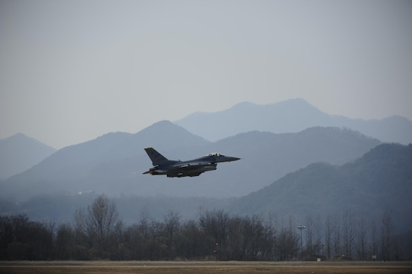An F-16 Fighting Falcon from the 80th Fighter Squadron takes off during Buddy Wing 16-3 at Jungwon Air Base, Republic of Korea, March 30, 2016. Buddy Wing training, held multiple times a year, polishes the ability of the Republic of Korea and U.S. pilots to train and operate as a combined force. (U.S. Air Force photo by Staff Sgt. Nick Wilson/Released)