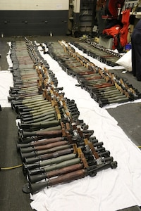(March 31, 2016) A cache of weapons is assembled on the deck of the guided-missile destroyer USS Gravely (DDG 107). The weapons were seized from a stateless dhow, which was intercepted by the Coastal Patrol ship USS Sirocco (PC 6) on March 28. The illicit cargo included 1,500 AK-47s, 200 RPG launchers, and 21 .50 caliber machine guns. Gravely supported the seizure following the discovery of the weapons by Sirocco's boarding team. This seizure was the third time in recent weeks international naval forces operating in the waters of the Arabian Sea seized a shipment of illicit arms, which the United States assessed, originated in Iran and was likely bound for Houthi insurgents in Yemen. The weapons are now in U.S. custody awaiting final disposition.