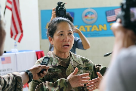 Major Marie O. Reed, 322nd Civil Affairs Brigade, 9th Mission Support Command, medical planner and operations intelligence officer of Exercise Balikatan 2016, addresses the media at a press conference following the opening ceremony for the exercise at Camp Peralta, Panay, Philippines, April 4, 2016. The ceremony signified the official start of the annual bilateral exercise that will run from 4-16 April. In Panay, Balikatan 2016 will consist of medical, dental, veterinary, and engineering civic actions, as part of humanitarian civic assistant projects. AFP and the U.S. military will work together to strengthen their longstanding alliance and to enhance the security and stability of the Philippine nation.