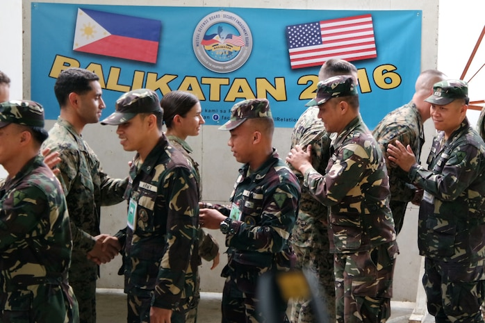 Armed Forces of the Philippines (AFP) and U.S. service members show camaraderie by shaking hands at the opening ceremony of Exercise Balikatan 2016 at Camp Peralta, Panay, Philippines, April 4, 2016. The ceremony signified the official start of the annual bilateral exercise that will run from 4-16 April. In Panay, Balikatan 2016 will consist of medical, dental, veterinary, and engineering civic actions, as part of humanitarian civic assistant projects. AFP and the U.S. military will work together to strengthen their longstanding alliance and to enhance the security and stability of the Philippine nation.