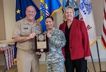 The 2016 Military Woman of the Year was Army Capt. Miracle Lopez Garcia. Garcia works as a price pending team supervisor in the Land Supplier Operations Directorate. She was given the award during Defense Supply Center Columbus' annual Women's History Month Luncheon March 23 at the Armed Forces Reserve Center on DSCC. Pictured with Garcia is Navy Rear Adm. John King, Land and Maritime commander, and Brenda Galowyn, DFAS.