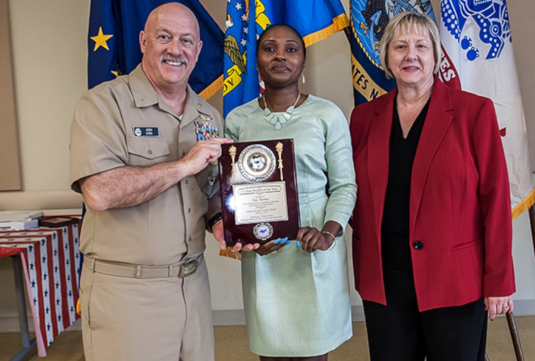 The 2016 Civilian Woman of the Year was Toye Thomas, an internal review evaluator with Land and Maritime. She was given the award during Defense Supply Center Columbus' annual Women's History Month Luncheon March 23 at the Armed Forces Reserve Center on DSCC. Pictured with Garcia is Navy Rear Adm. John King, Land and Maritime commander, and Brenda Galowin, DFAS.