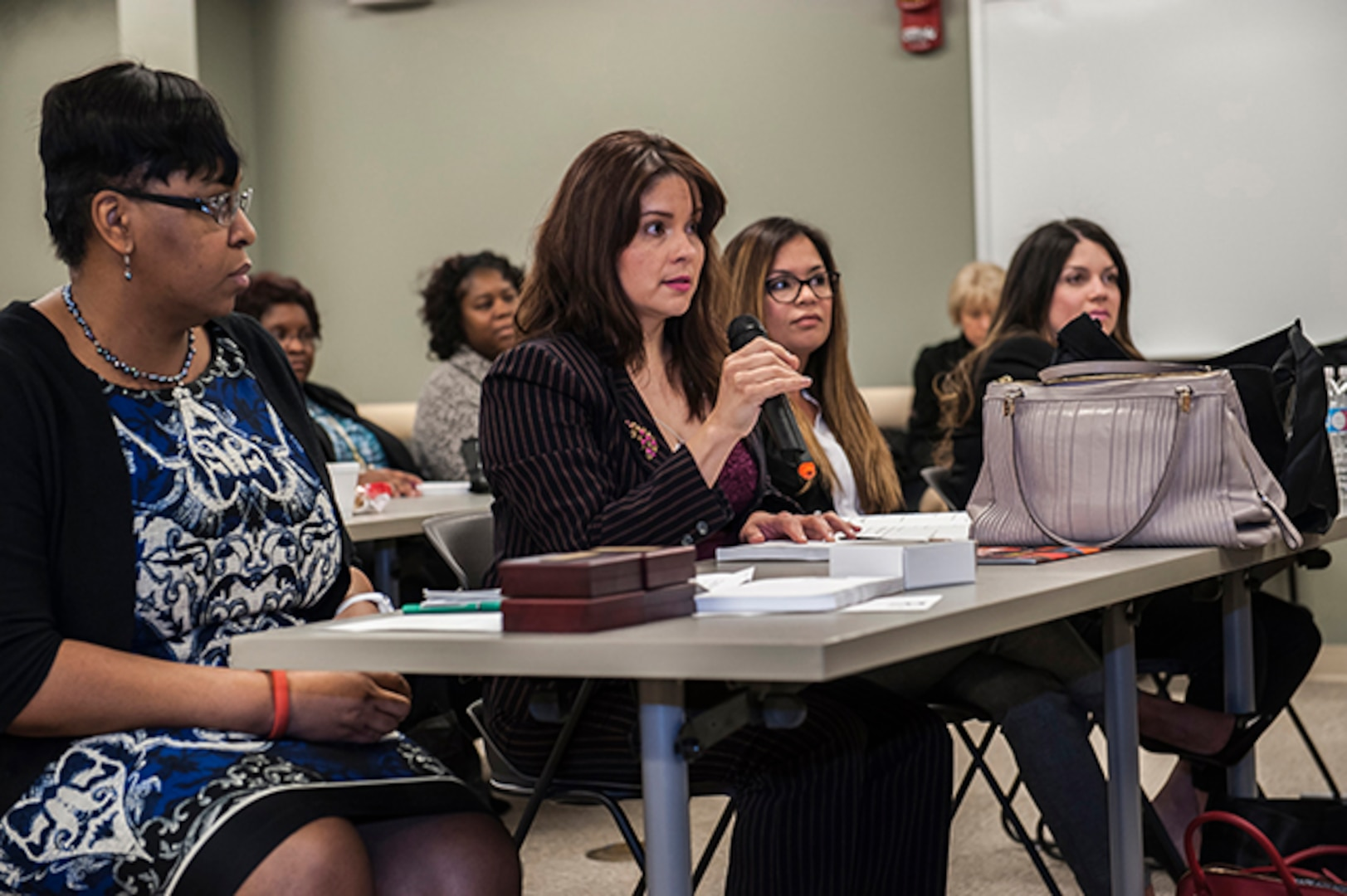 An attendee asks a question to a panelist at Defense Supply Center Columbus' Women's Leadership Summit March 23 in the Armed Forces Reserve Center (Building 2). The summit offered two workshops and a panel of four extraordinary women with diverse backgrounds in military, government and public service, sharing their career experiences to enable participants to enhance their leadership skills.