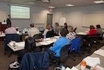Training attendees look on as John Dotchin provides a training introduction on day one.