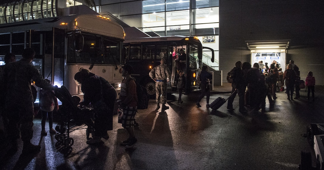 "Families affected by the ordered departure of dependents of service members and Defense Department civilian personnel currently stationed in Turkey arrive at Ramstein Air Base, Germany, March 30, 2016. As dependents departed Turkey, Ramstein AB has been designated as a ""transition location"" for families to await travel to their subsequent duty locations. (U.S. Air Force photo/Staff Sgt. Sara Keller)"