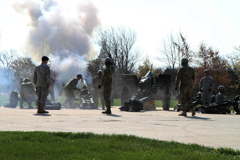 Canons roar during the 102nd Training Division (Maneuver Support) Change of Command ceremony to symbolically mark the tranfer of authority from outgoing commander Brig. Gen. John Elam to the 102nd's incoming commander, Brig. Gen. Miyako Schanely, at Ft. Leonard Wood, Mo., March 3, 2016.  The 102nd trains engineers, military police, and CBRN (chemical, biological, radiological, and nuclear) soldiers across the United States.