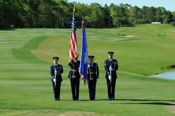 Members of the Keesler Honor Guard post the colors during the signing of the national anthem during the Mississippi Gulf Resort Classic closing ceremonies at the Fallen Oak Golf Course April 3, 2016. Col. Michele Edmondson, 81st Training Wing commander, and Keesler Airmen also participated in the festivities. (U.S. Air Force photo by Kemberly Groue)