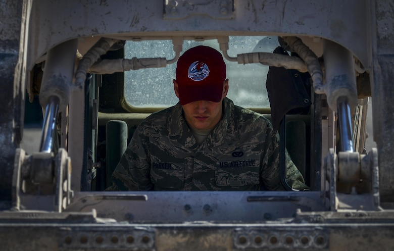Airman 1st Class Joshua Parker, 555th Red Horse Squadron heavy equipment operator, uses a loader to cover the lightning protection rods for the new firehouse at Nellis Air Force Base, Nev., April 2, 2016. In accomplishing what is needed, the 555th RHS has had an integral part in constructing the new firehouse on base. (U.S. Air Force photo by Airman 1st Class Kevin Tanenbaum)