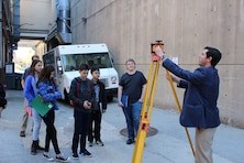Civil engineer Blaine Linkous discusses surveying and how it plays into designing buildings with students in downtown Baltimore as part of Easy as Pi student outreach program hosted by the Baltimore Chapter of the Society of Military Engineers in downtown Baltimore Wednesday, March 30. Linkous represented his employer, Maryland-based engineering firm WBCM, which along with the U.S. Army Corps of Engineers was one of several agencies and contractors with work in Science, Technology, Engineering and Math (STEM) that participated in the event geared toward exposing students to the variety of STEM careers that exist. (U.S. Army Photo by Johnita Jackson)