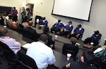 Players from the 1971 T.C. Williams High School Titans football team, featured in 'Remember the Titans,' gave a leadership presentation at the HQC March 31. The players, in blue jackets, are (from left) Julius Campbell, Wayne Sanders, Michael Lynch, Rufus Littlejohn and Darryl Stanton.