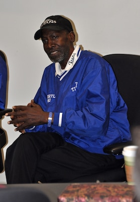 Darryl 'Blue' Stanton, DLA employee and one of the original players from the 1971 T.C. Williams High School Titans football team, relates a story to the audience.