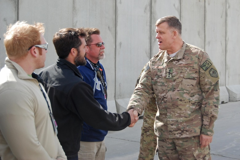 Gen. Frank Gorenc, the commander of NATO Allied Air Command and U.S. Air Forces in Europe - Air Forces Africa, shakes hands with MC-12W Liberty maintenance crewmembers during a visit to Bagram Airfield, Afghanistan, March 10, 2014. (U.S. Air Force photo/Capt. Brian Wagner)