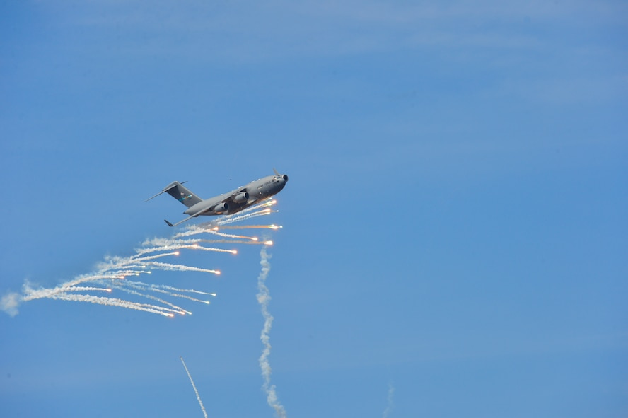 A C-17A Globemaster III from Dover Air Force Base, Del., expends countermeasure flares to defeat a simulated surface-to-air missile shot from a Man-Portable Aircraft Survivability Trainer system during a training mission March 24, 2016, at the Bollen Live-Fire Range Complex on Fort Indiantown Gap, Pa. A total of 240 flares were expended from the aircraft during the training mission. (U.S. Air Force photo/Senior Airman William Johnson)