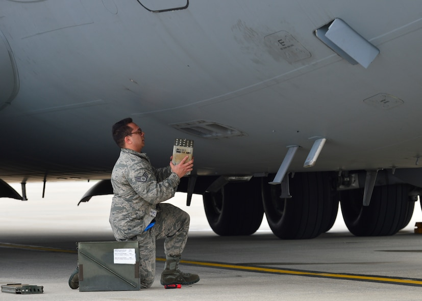 Staff Sgt. Matthew Calvo, a 736th Aircraft Maintenance Squadron communication, countermeasure and navigation system craftsman, uploads a flare magazine onto a C-17A Globemaster III on March 25, 2016, at Dover Air Force Base, Del. Each magazine consists of different flare sticks that are capable of defeating different infrared threats. (U.S. Air Force photo/Senior Airman William Johnson)
