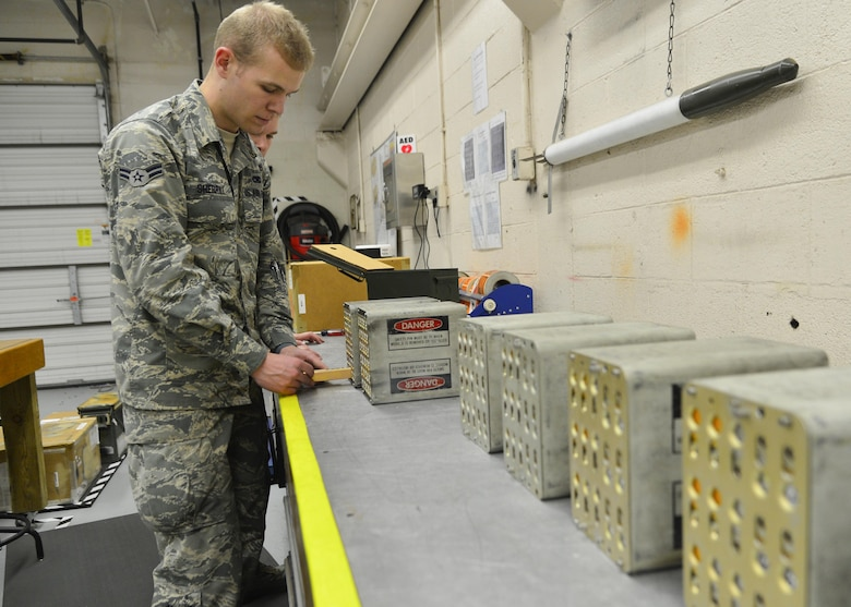Airman 1st Class Clay Sherrill, a 436th Maintenance Squadron munitions storage crewmember, loads a flare stick into a magazine box March 28, 2016, at Dover Air Force Base, Del. Once the magazine boxes are fully loaded, they are transported to the flightline to be uploaded onto the aircraft. (U.S. Air Force photo/Senior Airman William Johnson)