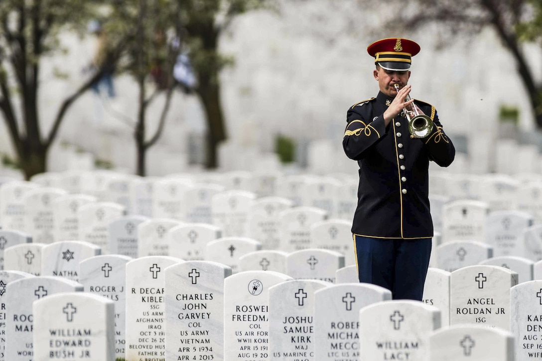 A soldier performs taps during a full-honors memorial service for Army Sgt. Wilson Meckley in Section 60 of Arlington National Cemetery in Arlington, Va., April 4, 2016. Meckley, who was assigned to the 7th Infantry Division's Company A, 1st Battalion, 32nd Infantry Regiment during the Korean War, was reported missing Dec. 2, 1950. On March 28, 2016, the Defense Department announced his body had been recovered. Army photo by Sgt. Cody W. Torkelson