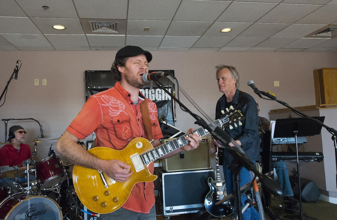 Brooks Hoover, singer; Dan Qualkinbush, bass guitar; and Paul Howe, drums; perform with the rest of the classic-rock band Moe Diggin April 1, 2016, at the Trail's End Event  Center grand opening on F.E. Warren Air Force Base, Wyo. The center's Wrangler Lounge will be open each weekend and other facilities can be booked for events. (U.S. Air Force photo by R.J. Oriez)