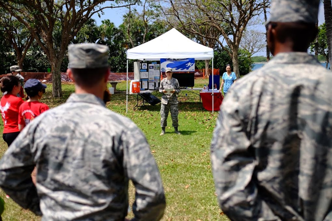 Staff Sgt. Sally Mason speaks to the crowd before the start of the fourth-annual 'One Mile Walk to Safety'  here, on April 1, 2016. The Walk to Safety is planned in conjunction with NOAA, state civil defense, City and County of Honolulu departments of emergency management and the American Red Cross and serves to raise awareness for the potential tsunami threat Hawaii faces. (U.S. Air Force photo by Staff Sgt. Christopher Stoltz/Released)