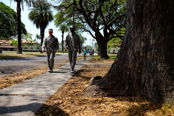 Col. Randall Huiss, 15th Wing commander, and Chief Master Sgt. Jerry Williams Jr., 15th Wing command chief, walk down Signer Ave. during the fourth-annual 'One Mile Walk to Safety'  here, on April 1, 2016. The Walk to Safety is planned in conjunction with NOAA, state civil defense, City and County of Honolulu departments of emergency management and the American Red Cross and serves to raise awareness for the potential tsunami threat Hawaii faces. (U.S. Air Force photo by Staff Sgt. Christopher Stoltz/Released)