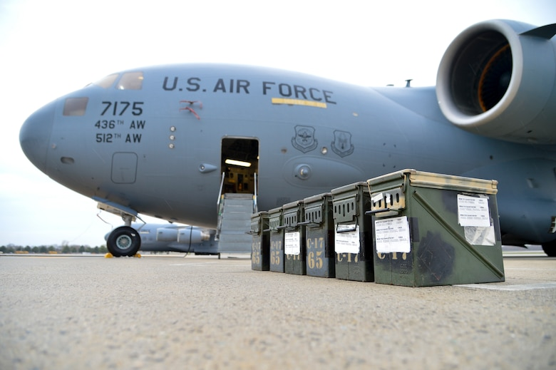 A flare set sits on the flight line next to a C-17A Globemaster III while preparations are made to the aircraft to upload the flares March 25, 2016, at Dover Air Force Base Del. The C-17 can hold up to 240 flare sticks, capable of defeating a wide range of infrared threats. (U.S. Air Force photo/Senior Airman William Johnson)