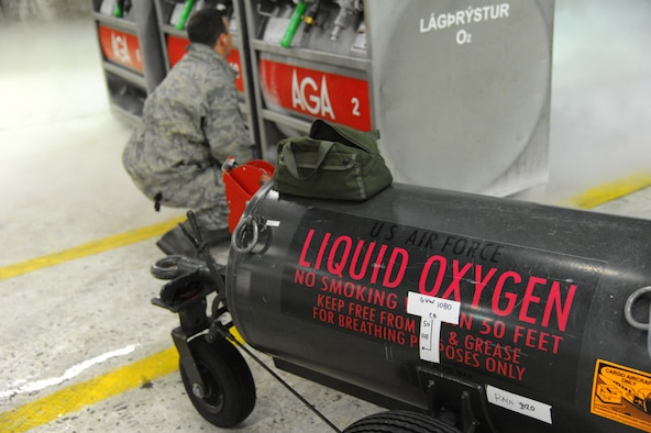 U.S. Air Force Master Sgt. Matt Leonard, an electro-environmental technician assigned to the 104th Maintenance Group, Barnes Air National Guard Base, Mass., inspects liquid oxygen tanks in a hardened aircraft shelter at Keflavik International Airport, Iceland, April 2, 2016. The tanks must be tested and fitted to the portable tank before transferring the liquid oxygen that will be used to replenish pilots' oxygen supplies within the aircraft. (U.S. Air Force photo by Master Sgt. Kevin Nichols)