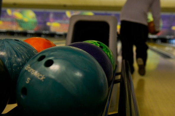 Bowling balls rest on a rack after being used during The Huddle March 30, 2016, at Ramstein Air Base, Germany. The Huddle is a senior NCO-led developmental program geared toward building rapport and providing a mentorship network for Airmen and NCOs. (U.S. Air force photo/Airman 1st Class Lane T. Plummer).