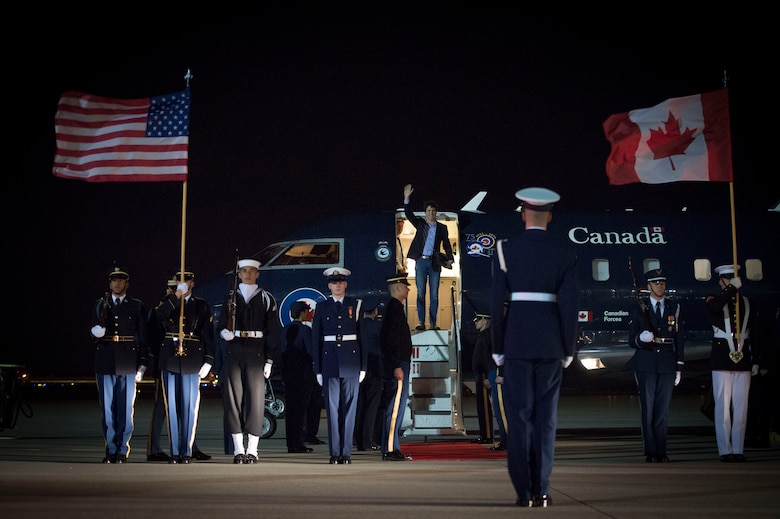 Members of Joint Base Andrews prepare for the arrival of Justin Trudeau, Prime Minister of Canada, on the JBA flightline March 30, 2016. More than 20 countries arrived here for the 2016 Nuclear Security Summit held in Washington, D.C. The summit provides a forum for leaders to reinforce commitments to securing nuclear materials. (U.S. Air Force photo by Senior Airman Mariah Haddenham/RELEASED)