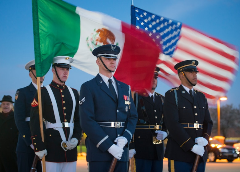 Joint Color Guard members prepare for the Mexican Presidential arrival on the Joint Base Andrews flightline, March 31, 2016. More than 20 countries are scheduled to arrive for the 2016 Nuclear Security Summit held in Washington, D.C. The summit provides a forum for leaders to reinforce commitments to securing nuclear materials. (U.S. Air Force photo by Staff Sgt. Chad C. Strohmeyer/RELEASED)