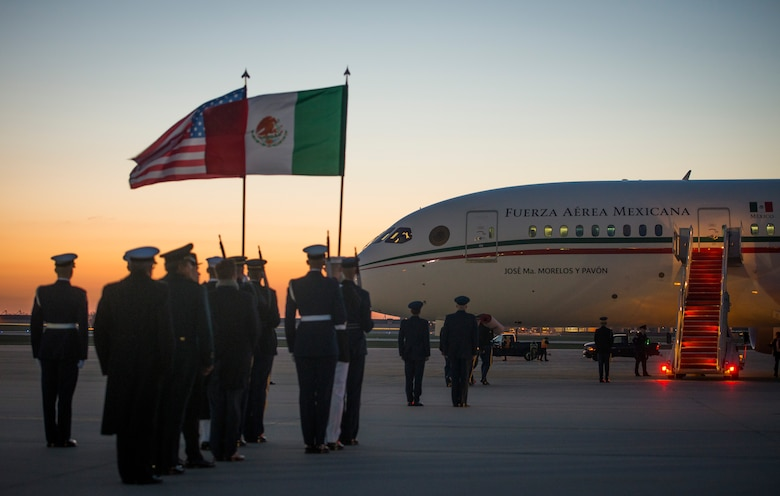 Joint Color Guard members stand at attention during the Mexican Presidential arrival on the Joint Base Andrews flightline, March 31, 2016. More than 20 countries are scheduled to arrive for the 2016 Nuclear Security Summit held in Washington, D.C. The summit provides a forum for leaders to reinforce commitments to securing nuclear materials. (U.S. Air Force photo by Staff Sgt. Chad C. Strohmeyer/RELEASED)