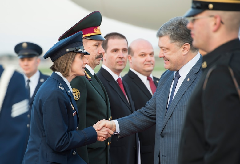 Col. Tiffany Dawson, 11th Wing Staff Judge Advocate director, greets Petro Poroshenko, Ukraine's president, on Joint Base Andrews, Md., March 30, 2016. Poroshenko, along with more than 20 other foreign leaders, arrived here for the 2016 Nuclear Security Summit held in Washington, D.C. The summit provides a forum for leaders to reinforce commitments to securing nuclear materials. (U.S. Air Force photo by Senior Airman Ryan J. Sonnier/RELEASED)
