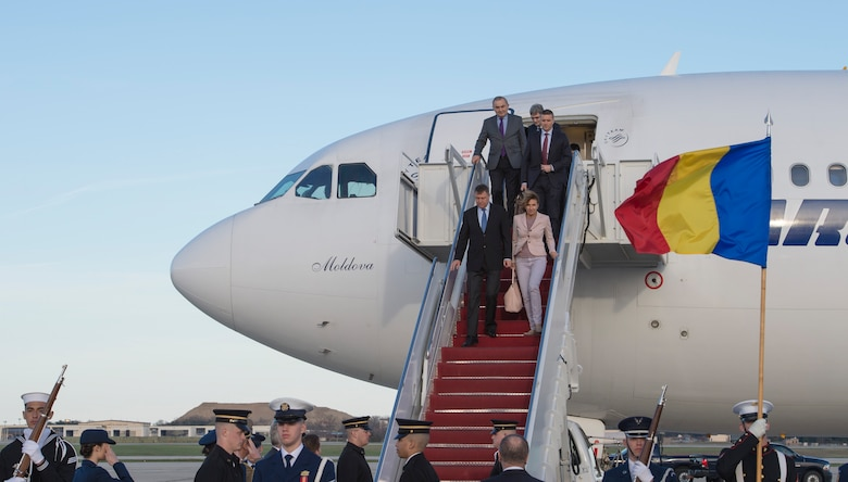 Klaus Iohannis, Romania's president, and his wife Carmen Johannis arrive at Joint Base Andrews, Md., March 30, 2016. Iohannis, along with more than 20 other foreign leaders, arrived here for the 2016 Nuclear Security Summit held in Washington, D.C. The summit provides a forum for leaders to reinforce commitments to securing nuclear materials. (U.S. Air Force photo by Senior Airman Ryan J. Sonnier/RELEASED)