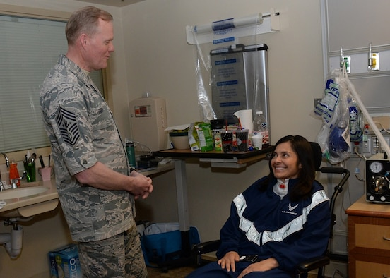 "Chief Master Sgt. of the Air Force, James A. Cody paid a personal visit to Maj. Katherine ""Kat"" Portillo, a wounded warrior from the Space and Missile Systems Center during the CMSAF's tour of Los Angeles Air Force Base in El Segundo, Calif., March 9-10, 2016. Following his full day visit with Airmen at the center, Cody took time to travel to the VA Medical Center in Long Beach with members of SMC's Space Superiority Directorate. (U.S. Air Force photo/Van De Ha)"